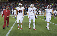 SEATTLE, WA - September 28, 2013: Stanford captains  from left, Kit Rodgers Ben Gardner, Trent Murphy and Shayne Skov walk on the field before play against Washington State at CenturyLink Field.