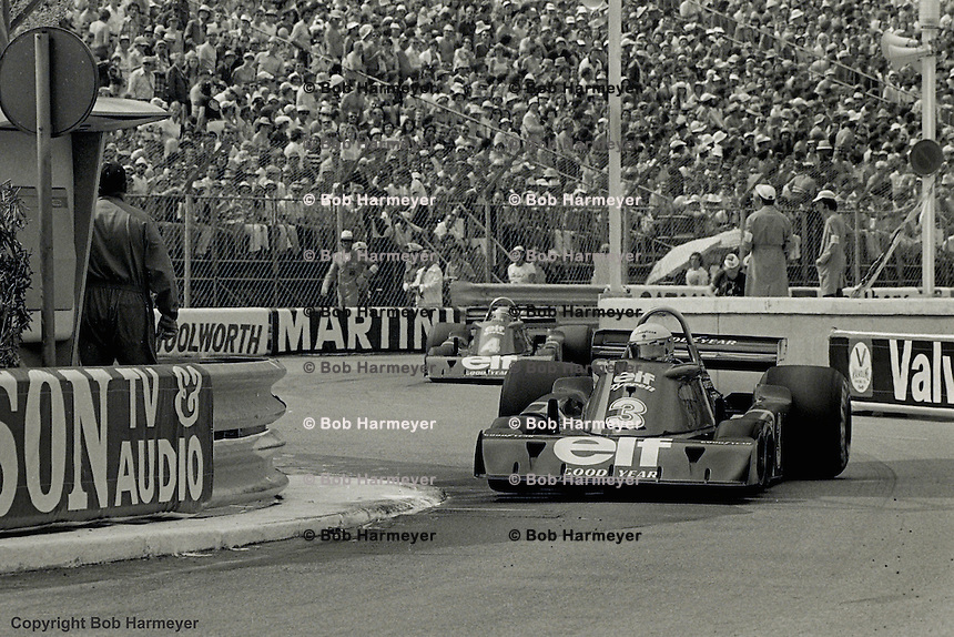 Jody Scheckter drives the Tyrrell P34 six-wheel Formula One car ahead of teammate Patrick Depailler during the 1976 Monaco Grand Prix.