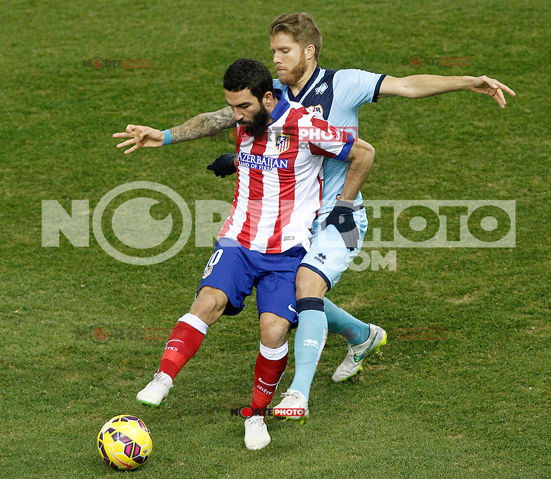 Atletico de Madrid's Arda Turan (l) and Rayo Vallecano's Jorge Garcia Morcillo during La Liga match.January 24,2015. (ALTERPHOTOS/Acero) /NortePhoto<br />