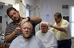 Greg Anderson cuts a customer's hair. Anderson has been working with Jim for about 14 years. He went to barber school with another barber, Dwayne, who introduced him to Jim Cloud. Photo taken at Jim Cloud Barbershop in London, Ky. on October 25, 2012. Photo by Quianna Lige