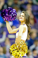 February 12, 2014:   UW Cheer member Kristina Koumaeva entertained fans during the game between Washington's against Stanford.  Washington defeated Stanford 64-60 at Alaska Airlines Arena in Seattle, Washington.