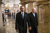 United States President Barack Obama and Vice President Joe Biden walk through the Crypt of the Capitol in Washington, Friday, Jan. 20, 2017, for Donald Trump's inauguration ceremony. <br /> Credit: J. Scott Applewhite / Pool via CNP