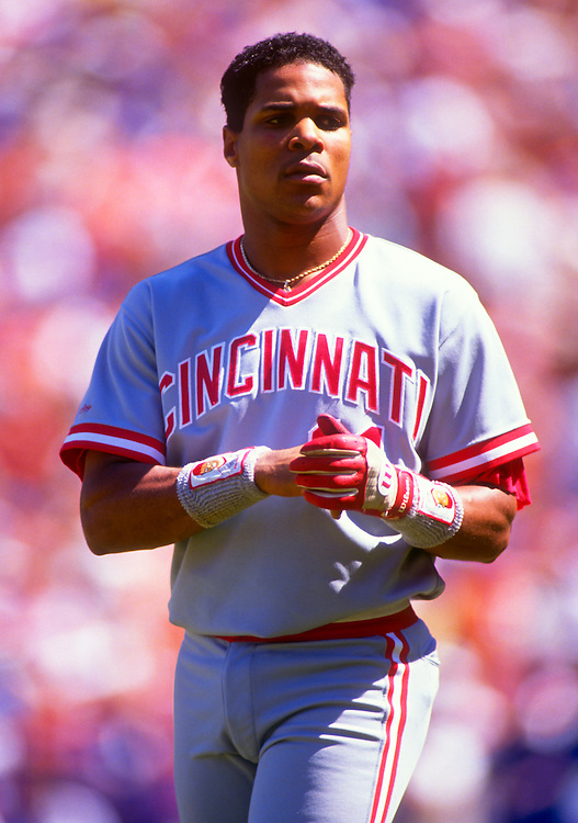 NEW YORK-CIRCA 1989:  Barry Larkin of the Cincinnati Reds looks on against the New York Mets during an MLB game at Shea Stadium in the Queens borough of New York City.  Larkin played for the Reds from 1986-2004.   (Photo by Ron Vesely)   Subject: Barry Larkin.