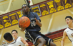 Eagle River's Savion Wilson finds space amid a trio of Dimond defenders.  Photo for the Star by Michael Dinneen