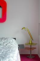 Close up of a designer bedside lamp in the bedroom
