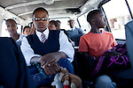 CAPE TOWN, SOUTH AFRICA - MARCH 15: Sikhumbuzo Hlahleni, age 15, rides in a taxi to train at Cape Town City Ballet's youth company on March 15, 2010 in Cape Town, South Africa. He trains in Cape Town every Saturday. He also trains a few days week at home in Khayelitsha, a poor township outside Cape Town. He has to change taxi three times to get to the school.  (Photo by Per-Anders Pettersson)