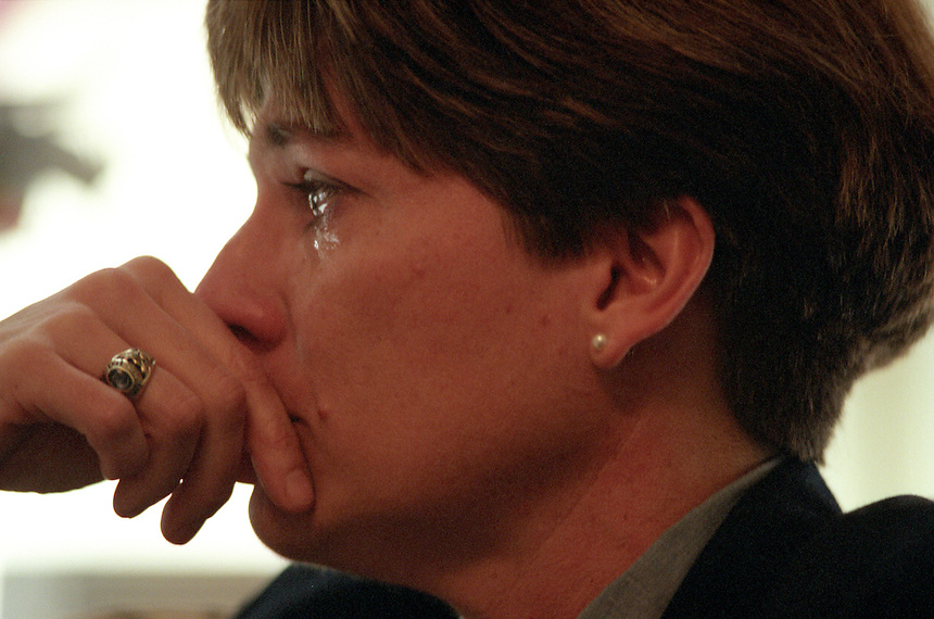 Brenda Hoster, a retired U.S. Army sergeant major, sheds tears as she relates her experience of sexual harassment by Sergeant Major of the Army Gene McKinney. McKinney was the highest-ranking enlisted man in the Army before he was relieved of duty pending investigation of Hoster's allegations. Hoster asserts McKinney propositioned her, kissed her without permission and touched her in a suggestive manner. She retired from service after her initial reports of the incident were ignored