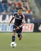 New England Revolution midfielder Lee Nguyen (24) brings the ball forward.  In a Major League Soccer (MLS) match, the New England Revolution (blue) tied D.C. United (white), 0-0, at Gillette Stadium on June 8, 2013.