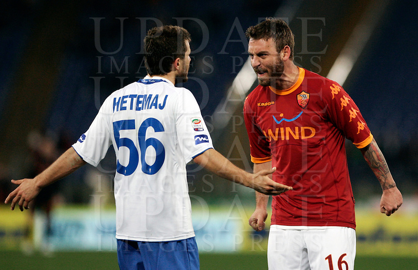 Calcio, Serie A: Roma-Brescia. Roma, stadio Olimpico, 2 febbraio 2011..Football, Italian serie A: AS Roma vs Brescia . Rome, Olympic stadium, 2 february 2011..AS Roma midfielder Daniele De Rossi, right, faces Brescia midfielder Perparim Hetemaj, of Finland..UPDATE IMAGES PRESS/Riccardo De Luca