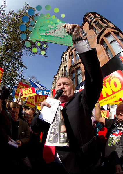 John Prescott holds a copy the Alternative Reginal Strategy on referendum campaign in Scotland. The Labour veteran was joined by Alistair Darling and Anas Sarwar all making stump speeches and campaign call's with local Labour activists.<br /> Picture: Universal News And Sport (Scotland) 10 September 2014.