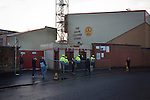 Motherwell 3 Dundee 1, 12/12/2015. Fir Park, Scottish Premiership. Spectators arriving at the turnstiles at the Davie Cooper Stand at Fir Park, home to Motherwell Football Club, before they played Dundee in a Scottish Premiership fixture. Formed in 1886, the  home side has played at Fir Park since 1895. Motherwell won the match by three goals to one, watched by a crowd of 3512 spectators. Photo by Colin McPherson.