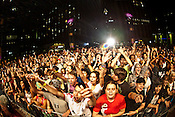 A large crowd fills City Plaza during Public Enemy's headline performance on the last night of the Hopscotch Music Festival in Raleigh, N.C., Sat., Sept. 11, 2010.