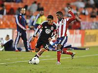 D.C. United defender Andy Najar (14) goes against Chicas USA midfielder Miller Bolanos (17) D.C. United defeated Chivas USA 1-0 at RFK Stadium, Sunday September 23, 2012.