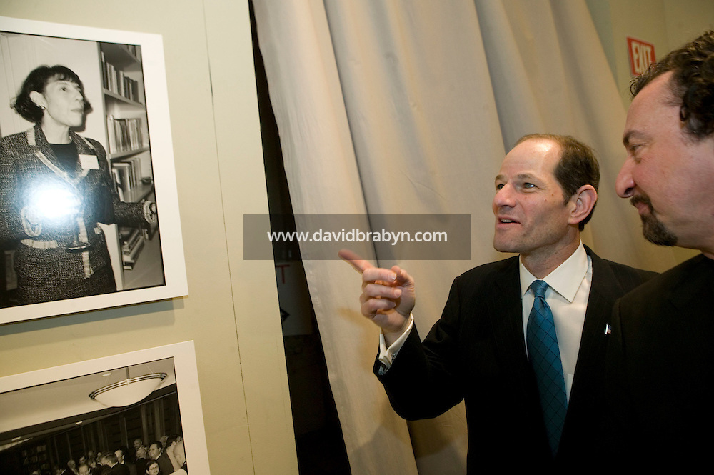"""11 January 2007 - New York City, NY - New York State Governor Eliot Spitzer (L) and photographer Marius Muresanu attend the opening of the """"Making of a Governor"""" photo exhibit on his 2006 campaign at Grand Central Station in New York CIty, USA, 11 January 2007."""