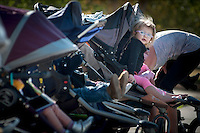 Haper Bonilla, 21 months, Scottdale,  watches for her mom , Nita, to return after skip-jumping  up the park path during a Fit4Mom class at Desert Horizon Park in Phoenix. The class uses portable equipment strollers and park landscape to help moms fit a workout into their busy schedules.