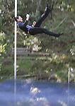 Gretchen Turzo enjoys a weekend of perfecting her art of flying on a trapeze in a oak grove in Sonoma.