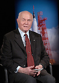 Former United States Senator John H. Glenn, Jr. (Democrat of Ohio) talks by satellite to the crew on board the International Space Station February 20, 2002 at NASA headquarters in Washington, DC. Glenn stopped by NASA to commemorate the 40th anniversary of his historic Mercury orbital flight. On February 20, 1962, Glenn became the first American to orbit the Earth, hurtling around the globe three times in a flight that lasted nearly five hours..Mandatory Credit: Bill Ingalls / NASA via CNP