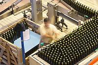 Bottling line. Man piling bottles. Vallformosa, Vilobi, Penedes, Catalonia, Spain