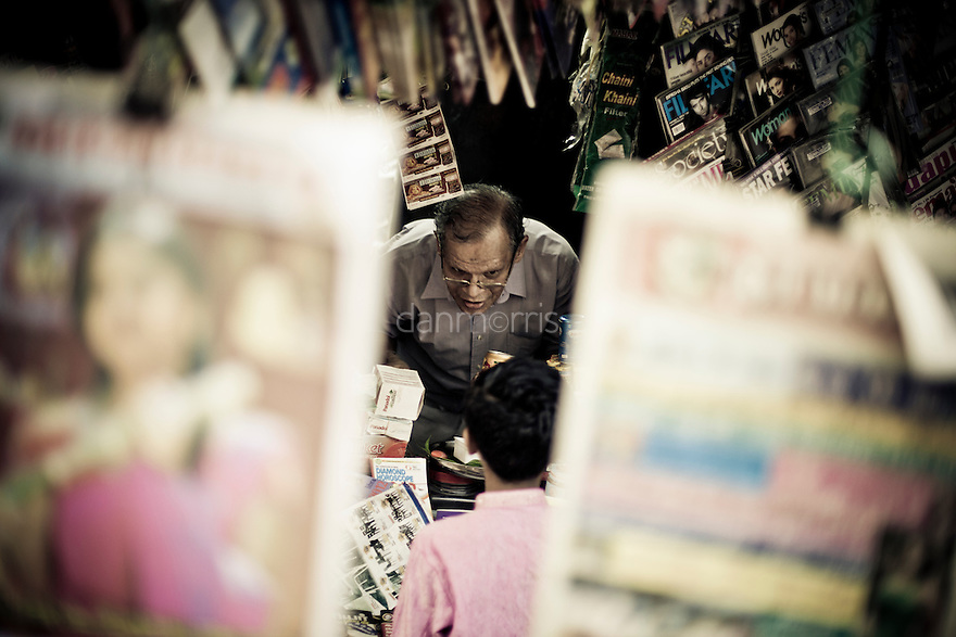 Magazine salesman in Little India, Kuala Lumpur