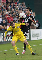 WASHINGTON, DC - OCTOBER 20, 2012:  Marcelo Saragosa (11) of D.C United pushes into the back of Eddie Gaven (12) of the Columbus Crew during an MLS match at RFK Stadium in Washington D.C. on October 20. D.C United won 3-2.