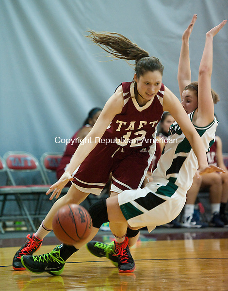 WATERTOWN CT-010814JS02-Taft's Hannah Friend (32) tries to drive past Deerfield's Becca Harrington (11) during their Wednesday at the Taft School in Watertown.  <br /> Jim Shannon Republican-American