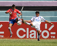 Malcon Frago (11) of Costa Rica fights for the ball with Gilberto Pena (2) of El Salvador during the group stage of the CONCACAF Men's Under 17 Championship at Jarrett Park in Montego Bay, Jamaica. Costa Rica defeated El Salvador, 3-2.