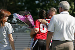26 October 2008: Duke's Cassidy Powers hugs head coach Robbie Church during Senior Day festivities. The Duke University Blue Devils defeated the Clemson University Tigers 6-0 at Koskinen Stadium in Durham, North Carolina in an NCAA Division I Women's college soccer game.
