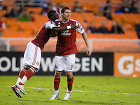 Kenny Cooper (33) of the Portland Timbers celebrates his goal with teammate Kalif Alhassan (11) during the game at RFK Stadium in Washington, D.C. D.C. United tied the Portland Timbers, 1-1.