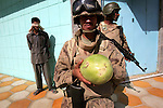 A detainee stands blindfolded after Marines from Kilo Co. 3rd Battalion 1st Marines (3/1) and Kilo Co. 3rd Battalion 25th Marines along with soldiers from the Iraqi Army decided to bring him in for questioning when he could not produce identification and was not recognized by people in the neighborhood during a joint patrol in the al-Anbar Province city of Hit on Sat. Sept. 17, 2005. i
