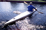 A kayakers swirls of his paddles and shimmer in the afternoon sunlight as he whisks away. Erik Kellar