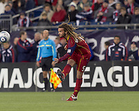 Real Salt Lake midfielder Kyle Beckerman (5) passes the ball. In a Major League Soccer (MLS) match, Real Salt Lake defeated the New England Revolution, 2-0, at Gillette Stadium on April 9, 2011.