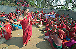 Women gather to celebrate International Women's Day on March 8, 2016, in Dhawa, a village in the Gorkha District of Nepal that was hard hit by a 2015 earthquake that ravaged the region.