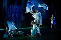 "London, UK. 15/11/2011. ""Seven for a Secret Never to be Told"" opens at Sadler's Wells. Dancers are: Eryck Brahmania, Atonette Dayrit, Julia Gillespie, Robin Gladwin, Dane Hurst, Vanessa Kang, Mbulelo Ndabeni, Pieter Symonds, Angela Towler, Stephen Wright. Standing: Mbulelo Ndabeni; seated: Pieter Symonds. Photo credit: Jane Hobson"