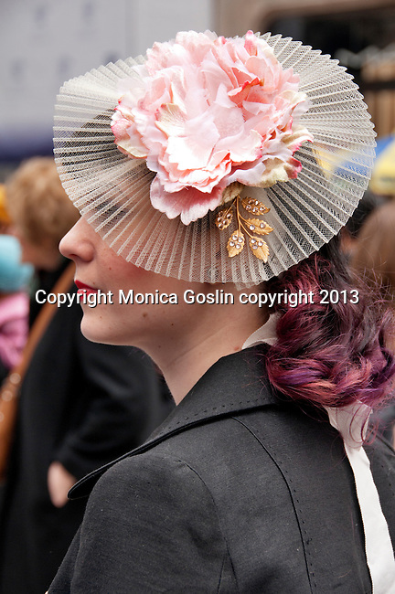 A woman wears a delicate hat with pink roses to the Easter Parade in New York City on Fifth Avenue