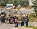 Jordan - Small children frequently come to attention and salute -- showing huge smiles -- whenever they see a military vehicle.  &copy; Rick Collier