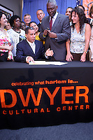 Domestic Workers Bill of Rights signed by Governor David Paterson at the Dwyer Cultural Center