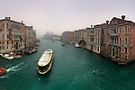 An early, foggy morning view of the Canal Grande as seen from the bridge of Accademia, with the church of the Salute in the background. Taken on a morning of mid January about one hour after sunrise, this is stitched from six vertical frames.