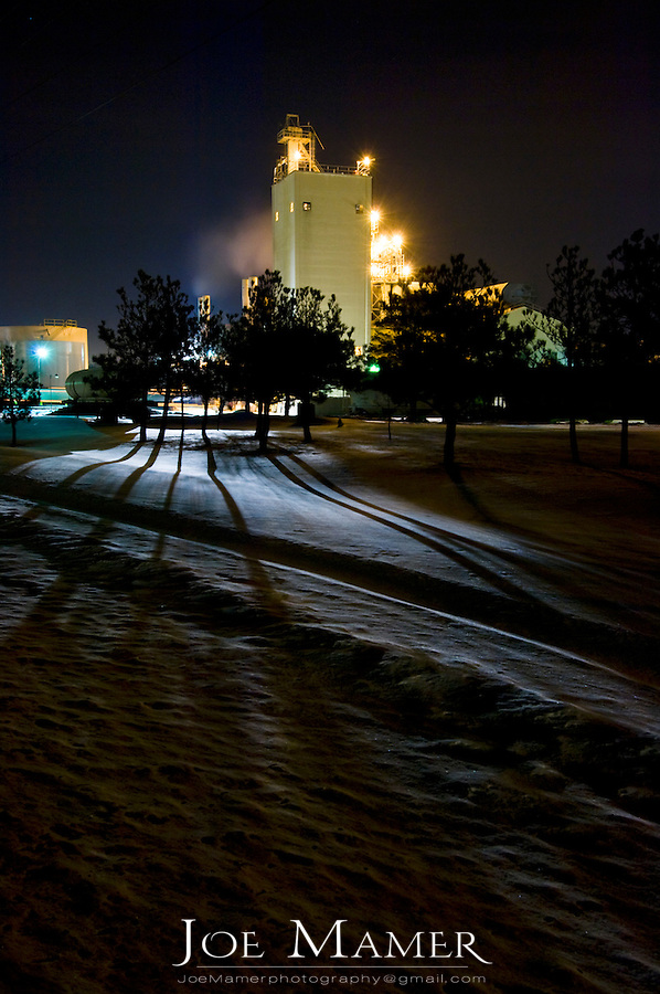 Lights from the Anchor Glass plant in Shakopee, Minnesota cast shadows at night.