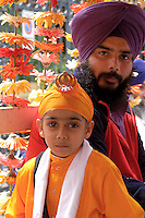 "Rome April 30 2006  .Piazza Vittorio  .Sikh ""Punj Pyare"" (Five Beloved Ones) lead a religious parade.The parade is for Visaki, a traditional Sikh celebration..Father and child Sikh  ."