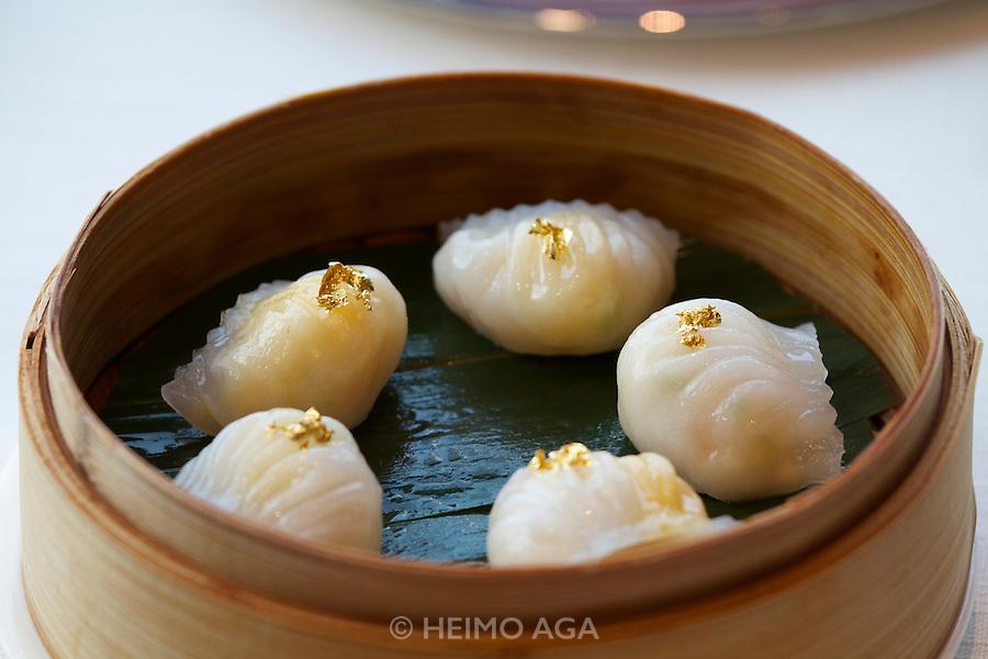 China, Hong Kong S.A.R..The Ritz-Carlton, Hong Kong. World's highest Dim Sum at Tin Lung Heen. Golden shrimp dumplings with bamboo shoots and asparagus.