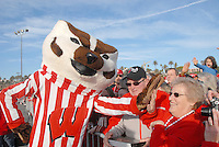 The  University of Wisconsin Badger mascot, Bucky Badger, greets fans at the  Santa Monica Pier during their official Rose Bowl Pep Rally   on Thursday, December 30, 2010