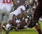 Mississippi State quarterback Chris Relf (14) is tackled by Mississippi's Joel Kight (15) in Starkville, Miss. on Saturday, November 26, 2011. (AP Photo/Oxford eagle, Bruce Newman)