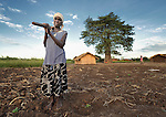 "Alefa Soloti stands in her field of sesame in Dickson, a village in southern Malawi that has been hard hit by drought in recent years, leading to chronic food insecurity, especially during the ""hunger season,"" when farmers are waiting for the harvest."