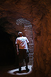 A man looks up through a mine shaft in an opal mine.  Coober Pedy, South Australia, AUSTRALIA.