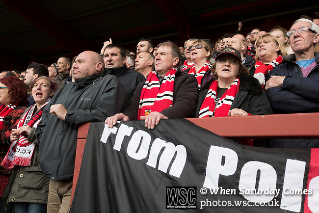 FC United of Manchester 0 Benfica 1, 29/05/2015. Broadhurst Park, Stadium Opening. Home fans at Broadhurst Park, Manchester, the new home of FC United of Manchester during the first-half of the club's match against Benfica, champions of Portugal, which marked the official opening of their new stadium. FC United Manchester were formed in 2005 by fans disillusioned by the takeover of Manchester United by the Glazer family from America. The club gained several promotions and played in National League North in the 2015-16 season, but lost this match 1-0. Photo by Colin McPherson.