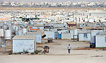 The Zaatari refugee camp near Mafraq, Jordan. Established in 2012 as Syrian refugees poured across the border, the camp held more than 80,000 refugees by 2015, and was rapidly evolving into a permanent settlement. The ACT Alliance provides a variety of services to refugees living in the camp.