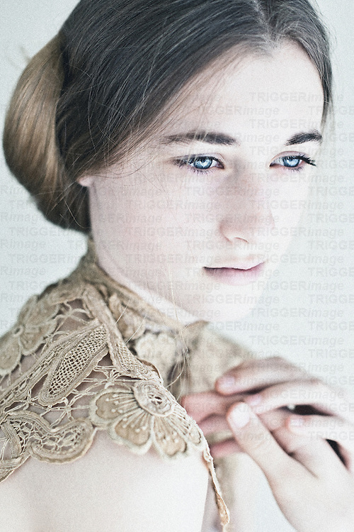 Close up of young girl with lace neck decoration