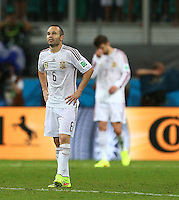Andres Iniesta of Spain, scorer of the winning goal in the last World Cup Final, played between these two sides, shows a look of dejection as his side fall to a 1-5 defeat