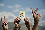 QANDIL, IRAQ: People hold photographs of PKK leader Abdullah Ocalan during Newroz celebrations in the PKK controlled area of Qandil in the north of Iraqi Kurdistan...On March 21st 2013, during the Kurdish new year festival of Newroz, jailed PKK (Kurdish Workers Party) leader Abdullah Ocalan released a statement calling on the PKK to cease hostilities and withdraw from Turkey back to northern Iraq...Photo by Hawre Muhamed/Metrography