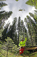 Rescue paramedic Asbjørn Møller attach himself to a rope below the helicopter during a pick up training mission. Norwegian Air Ambulance operating EC 135 helicopter out of their base in Trondheim, one of eight bases operated by the company.